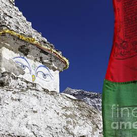 Robert Preston - Buddhist stupa and prayer flags at Dingboche village in the Everest Region of Nepal