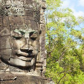 Faces of Bayon temple by Alexey Stiop