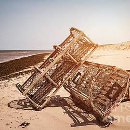 Lobster traps on beach by Elena Elisseeva