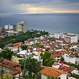 Puerto Vallarta rooftops and Pacific ocean by Elena Elisseeva