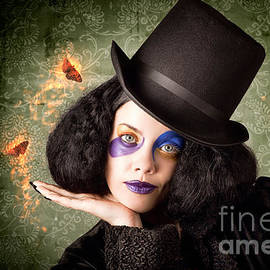 Stylish Female Magician Performing Magic Trick by Jorgo Photography - Wall Art Gallery