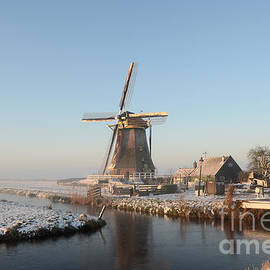 Winter windmill landscape in Holland by IPics Photography