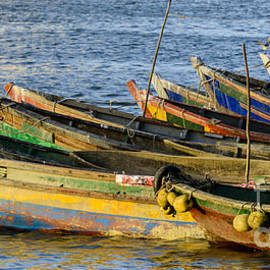 Colorful fishing boats by Oscar Gutierrez