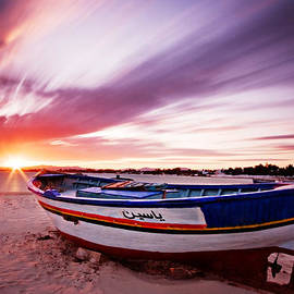 Fishing Boat At Sunset / Tunisia by Barry O Carroll