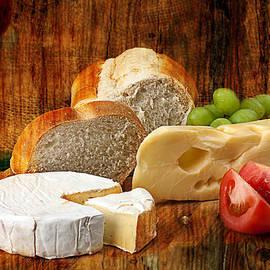 Norwegian Jarlsberg and Camembert by Gunter Nezhoda
