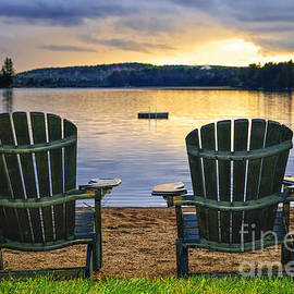 Wooden chairs at sunset on beach 2 by Elena Elisseeva