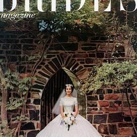 A Bride In Front Of Stone Gate by Carmen Schiavone