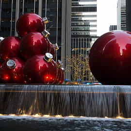 A Christmas Card from New York City - Manhattan Skyline Reflecting in Giant Red Balls