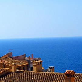 Tina M Wenger - Adobe Roofline And Blue Seas