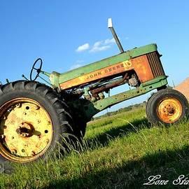Antique John Deer Tractor by Tessy  Braun