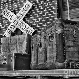 Baggage Pickup At The Railroad Depot In Black and White by Thomas Woolworth