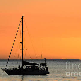 David Hill - Beautiful tropical sunset over the ocean with yacht