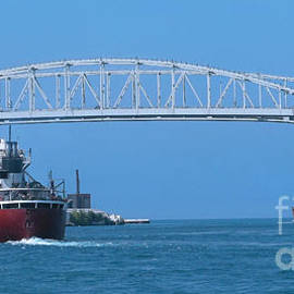 Blue Water Bridge And Freighters by Ann Horn