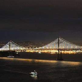 Boat and San Francisco Oakland Bay Bridge Alighted by Ron McMath