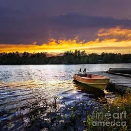 Elena Elisseeva - Boat on lake at sunset