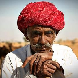 Camel Herder India by Henry Kowalski