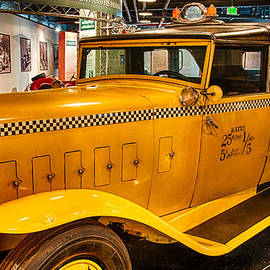 Classic Checkered Taxi by Gene Sherrill
