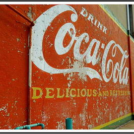 Coca-Cola on the Army Store Wall by Kathy Barney