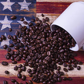 Coffee Cup On American Flag by Garry Gay