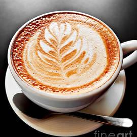 Coffee latte with foam art by Elena Elisseeva