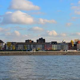 Colorful houses across Rhine River Cologne Germany by Imran Ahmed
