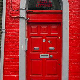 Colorful red door on red wall by RicardMN Photography
