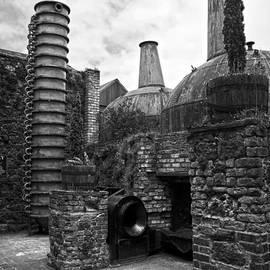 Copper pot stills and column still at Lockes Distillery BW by RicardMN Photography