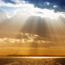 Crepuscular Rays Over City by Julius Reque