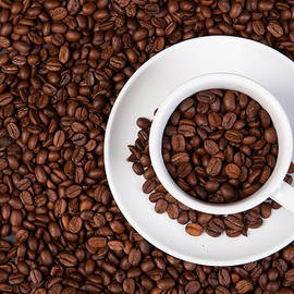 Cup Of Coffee Beans by Raimond Klavins