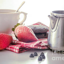 Cup of tea with strawberries by Sviatlana Kandybovich