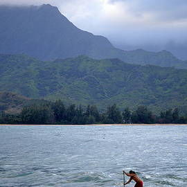 Dog and Man Paddleboarding in Hanalei Bay by Catherine Sherman
