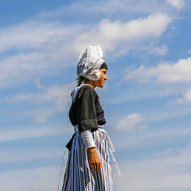 Dutch girl in traditional clothing by Patricia Hofmeester