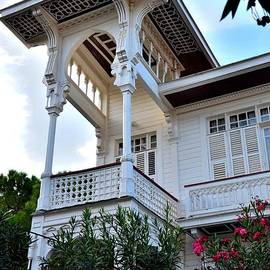 Elegant white house and balcony by Imran Ahmed