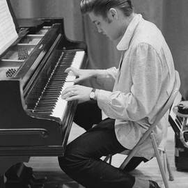 Elvis Presley On Piano While Waiting For A Show To Start 1956 by The Harrington Collection