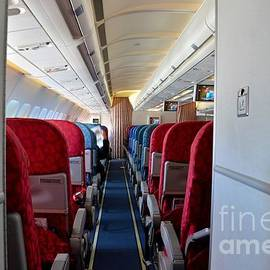 Empty aircraft seats inside airplane cabin by Imran Ahmed