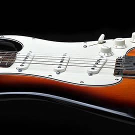 Fender Stratocaster Guitar On Black Background by Todd Aaron