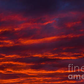 Fiery Sunset Sky by Les Palenik