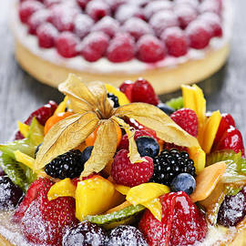 Fruit and berry tarts by Elena Elisseeva