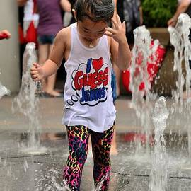 Imran Ahmed - Girl child plays with water at fountain Singapore