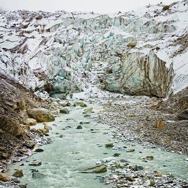 Raimond Klavins - Glacier and river in mountain