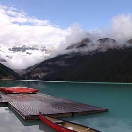 Victoria Glacier Canoes - Lake Louise, Alberta by Ian Mcadie
