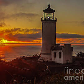 Golden Sunset at North Head Lighthouse by Robert Bales