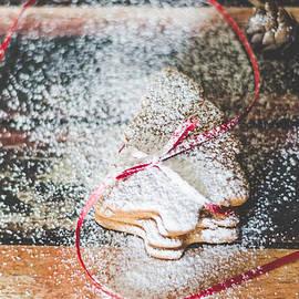 Homemade Christmas cookies sprinkled with powdered sugar by Aldona Pivoriene