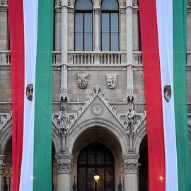 Hungary flag hanging at Parliament Budapest by Imran Ahmed