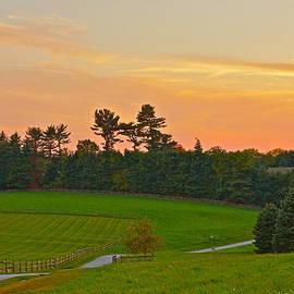 Hunter's Moon Rosy Sunset At The Farm by Byron Varvarigos