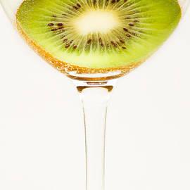 Kiwi fruit cut in half by Alexander Voss