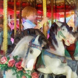 Little Boy on Carousel by Susan Savad