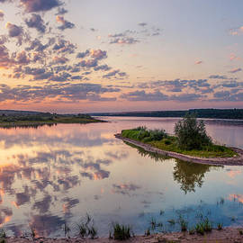 Little island on sunset by Dmytro Korol