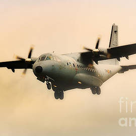 Military Transport Aircraft Coming Out Of The Mist by Nick  Biemans
