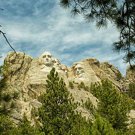 Natural Focal Point Photography - Mount Rushmore Through Foliage